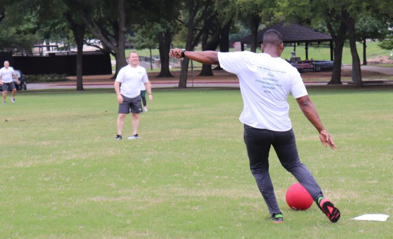 Donnie Upshaw playing kickball with the team.