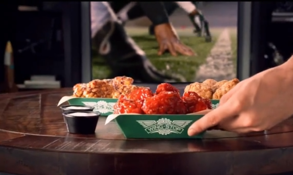 Wingstop Super-Fans enjoying a big night in with boneless wings and football
