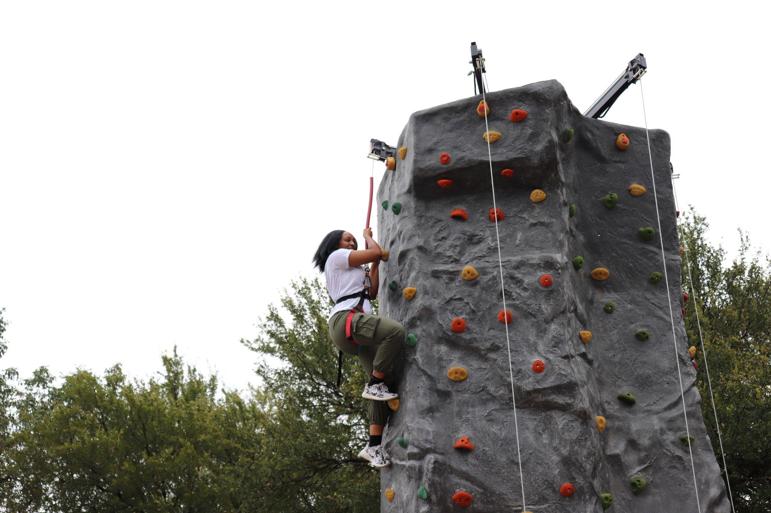 Rock wall climbing during team member appreciation week.