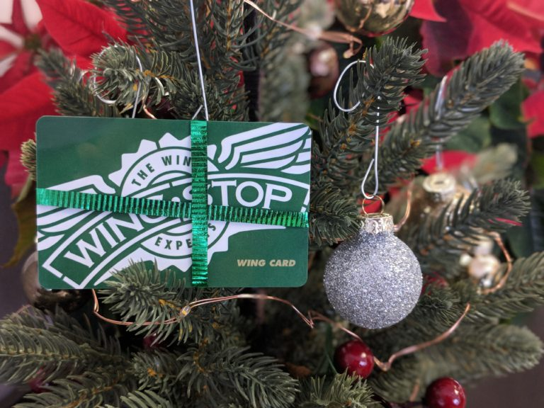 Wingstop gift card hanging on a Christmas tree