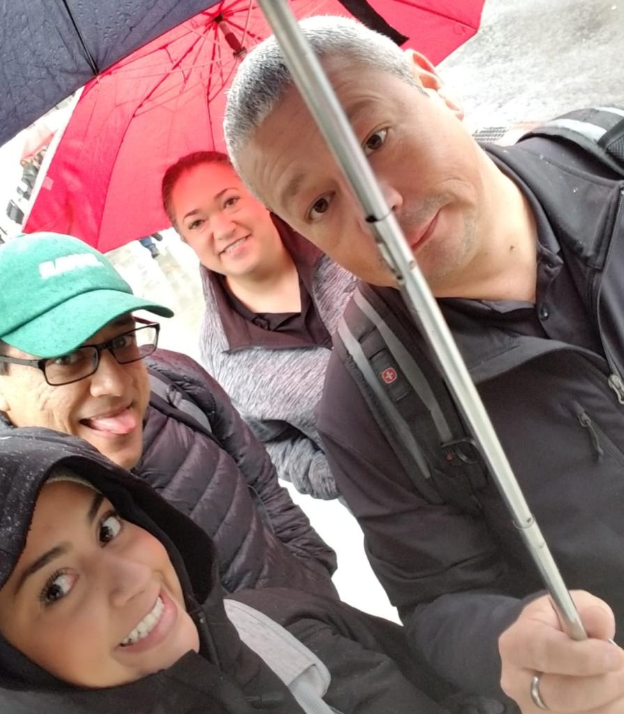 Wingstop U.K. NRO team taking a selfie in the rain.