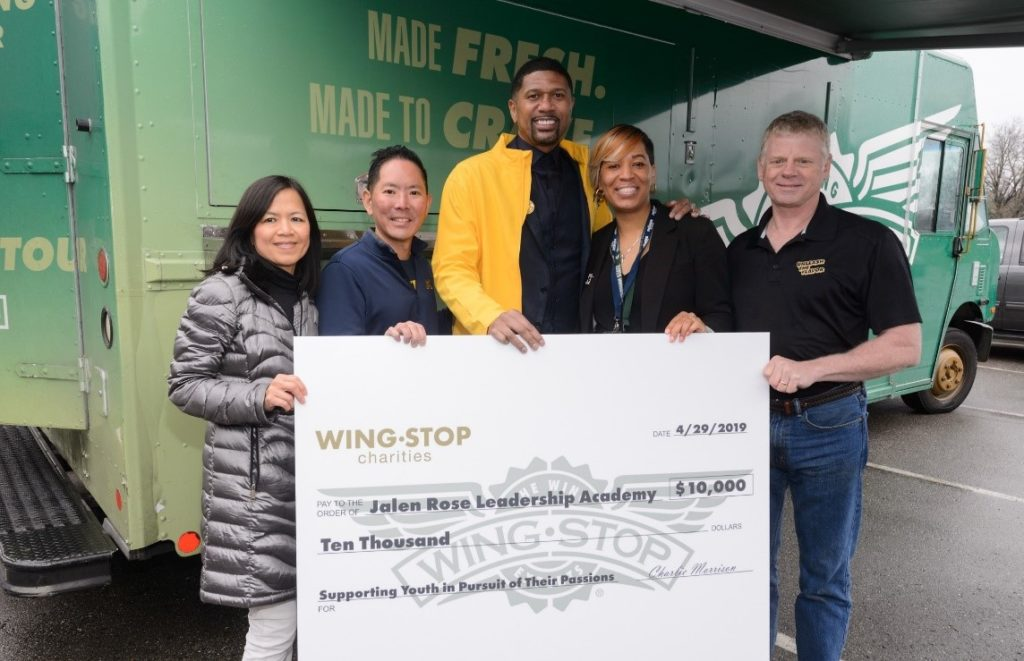 Check presentation from left to right brand partners Annie and Tommy Pipatjarasgit Jalen Rose principal Wendie Lewis and brand partner Steve Davidson.