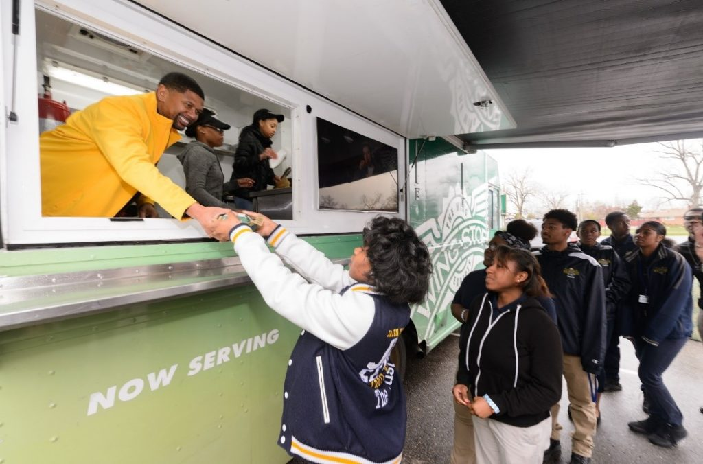 Students proudly yelled their GPA prior to receiving wings served up by an ecstatic Jalen Rose.