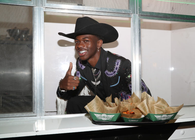Lil Nas X on Wingstop Truck. Caption: Ready to take the Old Town Road on the Wing Truck.