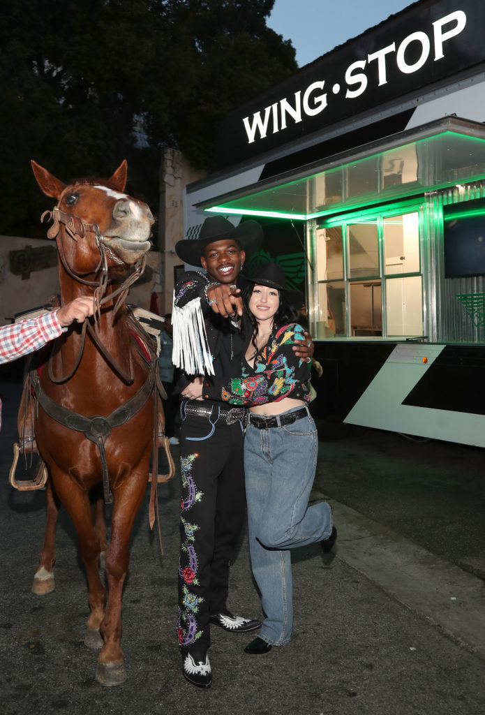 Lil Nas X and Noah Cyrus with horse