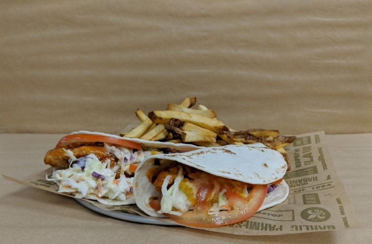 Wingstop Mango Habanero Slaw Tacos with Wingstop fries.