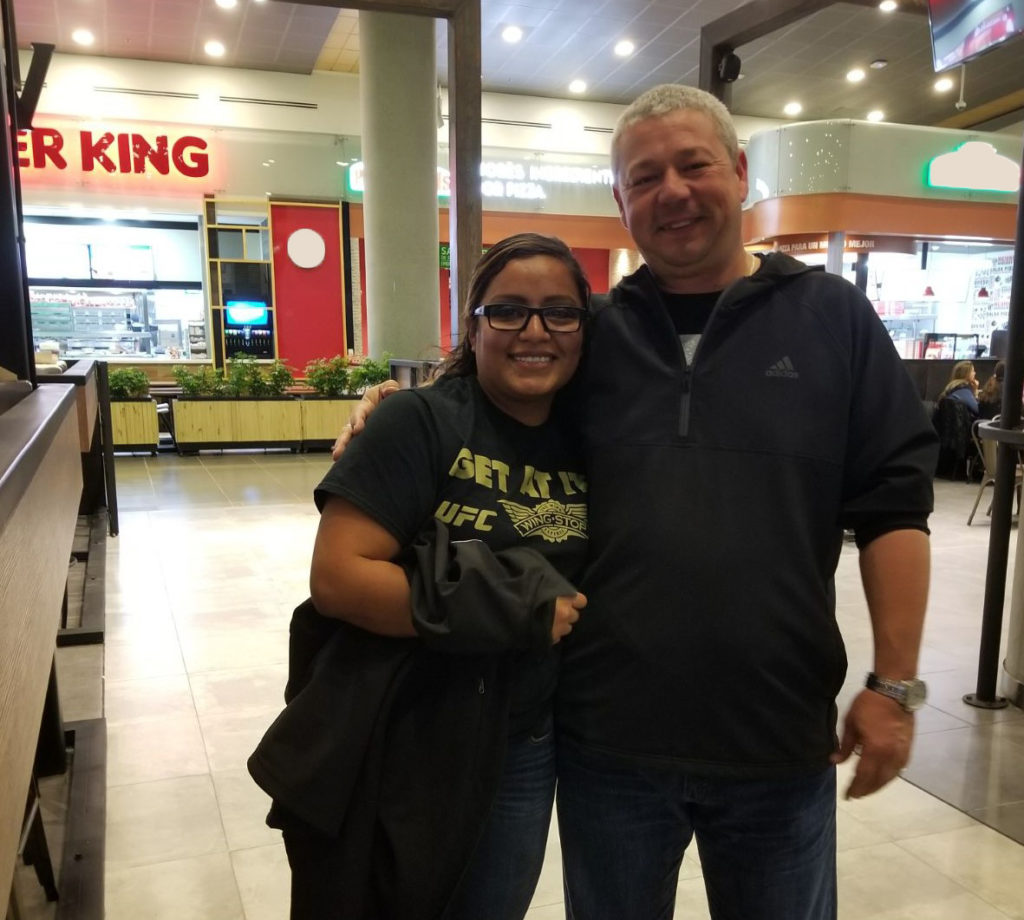 Phillip mentoring Alma Arriaga, now district manager, during her first international opening in Colombia.