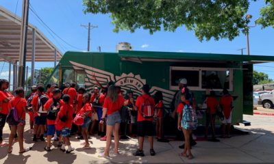 Wingstop Charities Gives Back to Boys and Girls Club The Wing Truck served lunch to 200 summer camp students.