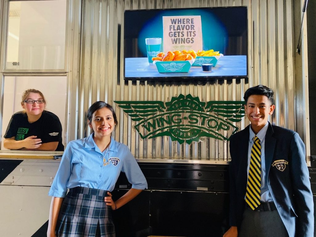 Cristo Rey Fort Worth students at Wingstop truck