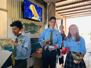 Cristo Rey Fort Worth students getting wings form the truck